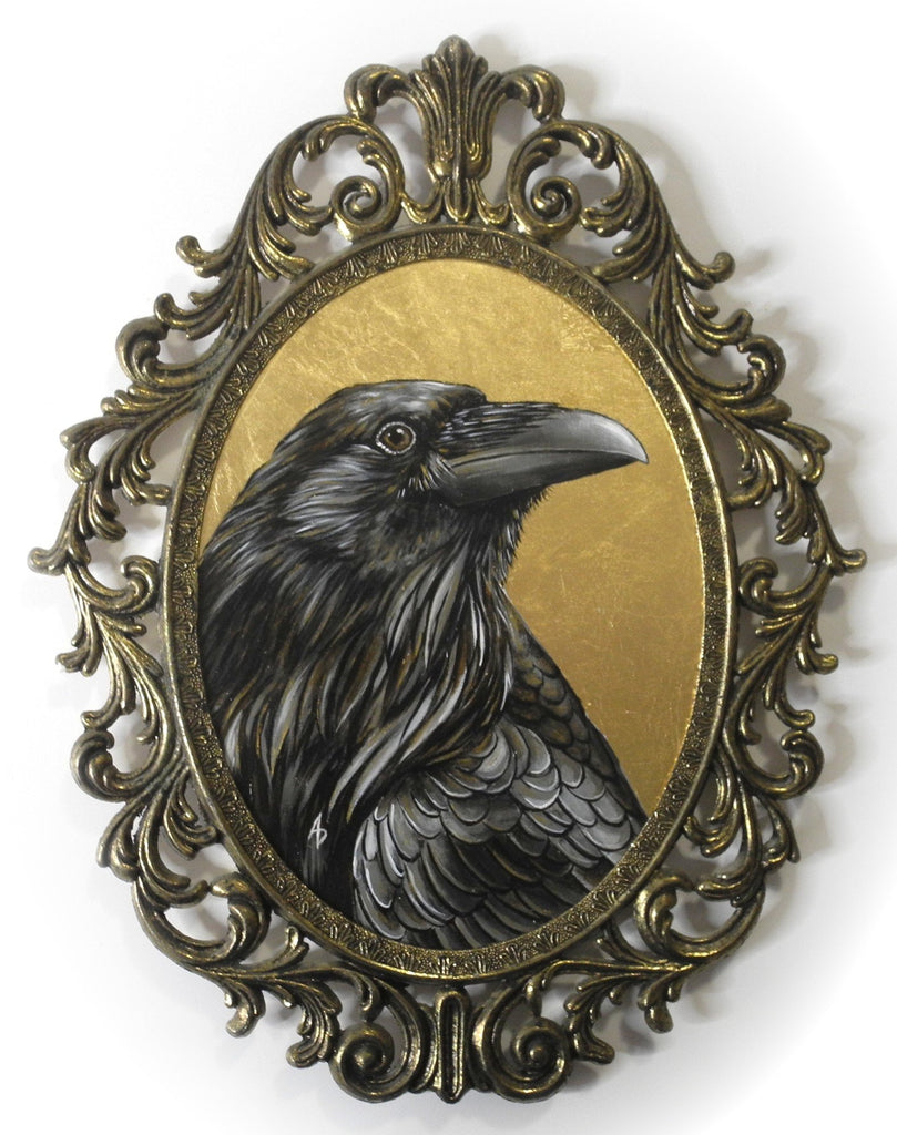 gold leaf raven art in vintage filigree oval frame