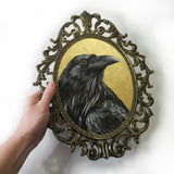Gold Leaf Raven painting in ornate brass frame, corvidae art