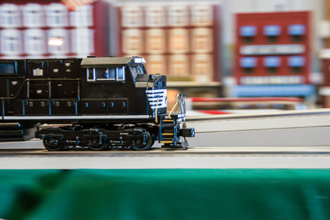 HO model train engine driving forward