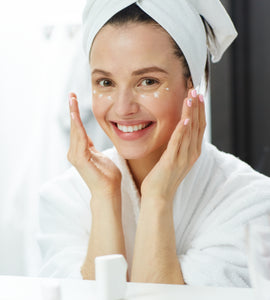 Woman applying Anti-Aging Moisturizer to her face