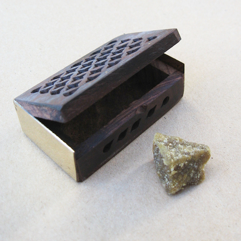 Amber resin with filigree box