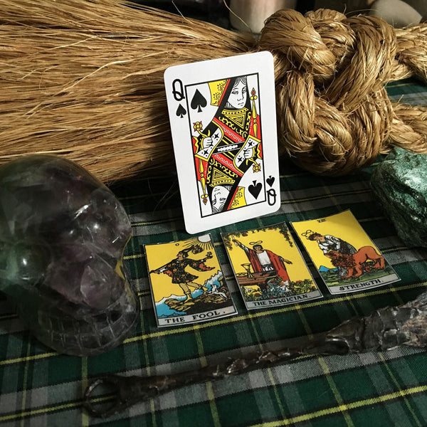 Tarot card reading with wand and crystals