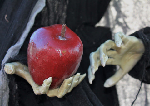 Witch holding poison apple