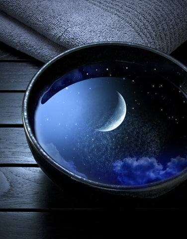 Moon reflected in a bowl of water