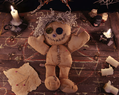 Voodoo doll with candles
