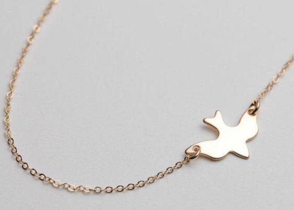 Peace Dove Pendant: available in silver or gold