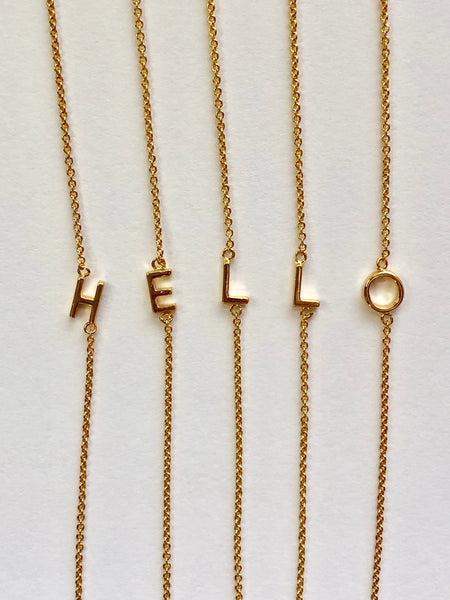 Mini Sideways Letter Necklace: available in gold.