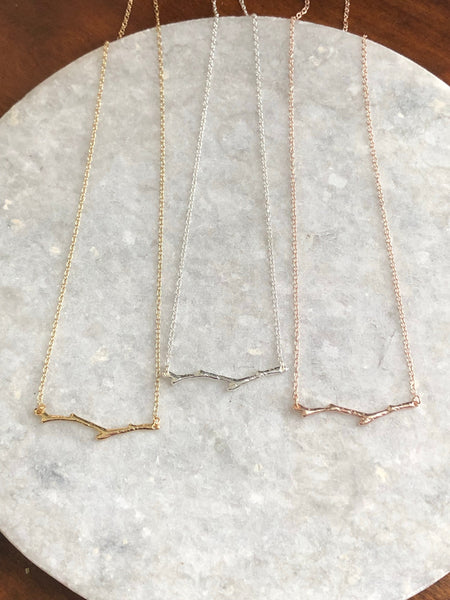 Twig Necklace: available in silver, gold, and rose gold.