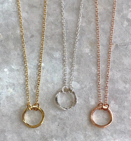Curvy Karma Necklace: available in silver, gold, and rose gold.