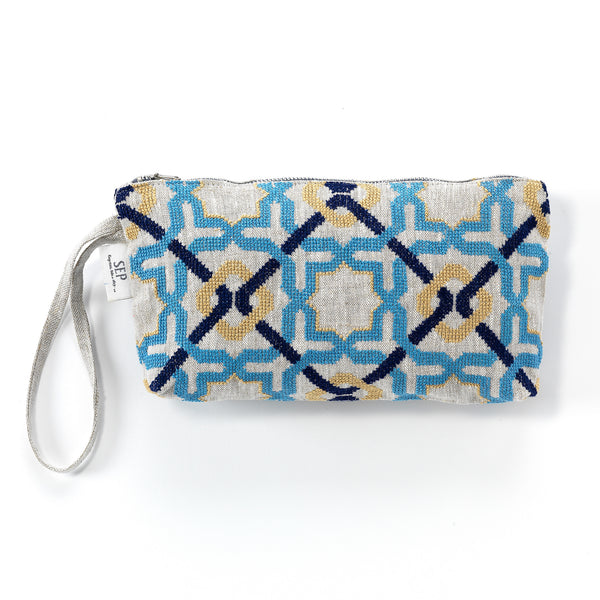 hand-embroidered linen pouch craftsmanship luxury by refugees