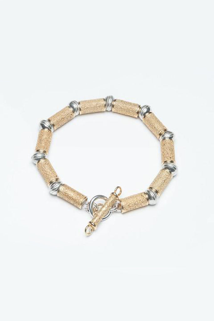 textured bead bracelet contemporary gold and oxidised silver textured bracelet made in england