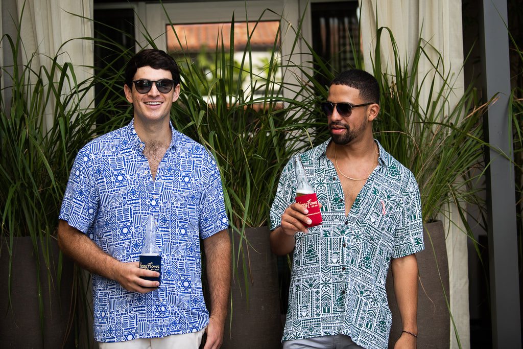 two guys wearing hannukah and christmas hawaiian shirts by kenny flowers