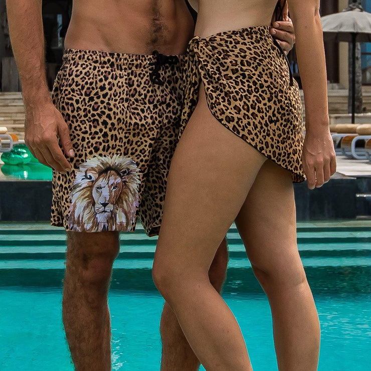 Animal print matching couples outfit with leopard print sarong and trunks by Kenny Flowers