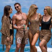 Animal print outfits by Kenny Flowers with leopard print kimono, trunks, one piece swimsuit, and sarong