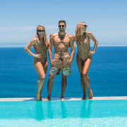 Matching animal print swimwear for men and women by Kenny Flowers