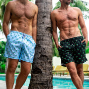 Light blue and black mens swim trunks with micro-print palm trees by Kenny Flowers