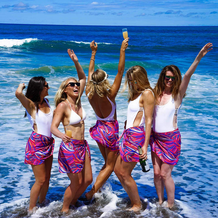 Cute bachelorette party outfits matching sarongs by Kenny Flowers