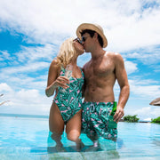 Honeymoon outfits matching palm print trunks and one piece swimsuit by Kenny Flowers