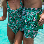 Palm leaf print trunks and one piece swimsuit by Kenny Flowers