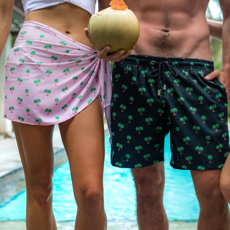 Matching outfit for couples honeymoon outfits sarongs and trunks by Kenny Flowers