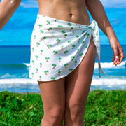 White sarong with palm tree print beach cover up by Kenny Flowers