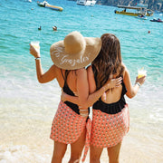 matching pineapple print sarongs beach party outfits