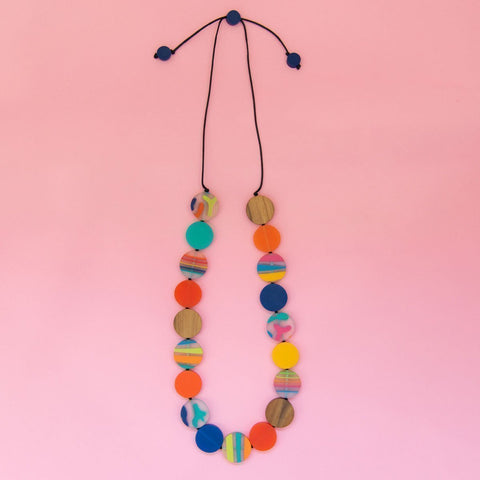 RO1965-M-MULTI-Rainbow-Bright-Long-Disc-Necklace-Pink-Background-Flatlay-1200x1200.jpg