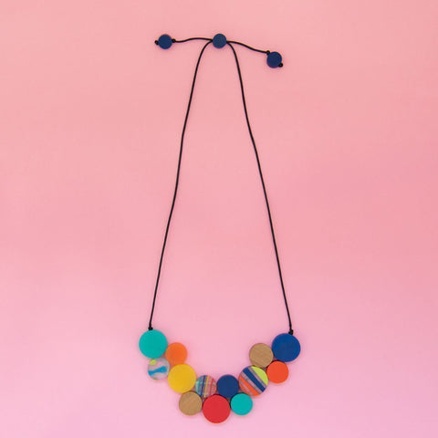 RO1966-M-MULTI-Rainbow-Bright-Short-Disc-Collar-Necklace-Pink-Background-Flatlay-1200x1200.jpg