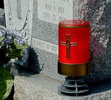 red  flameless LED battery operated electric candle with cross on a  memorial headstone