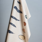 blue feather and egg printed cotton tea towel
