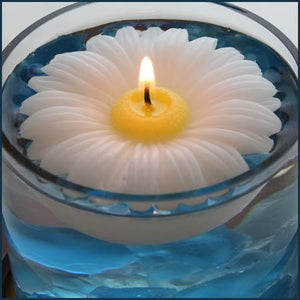 Daisy floating candles are the original design made by Armadilla Wax Works, Prescott Valley, Arizona.