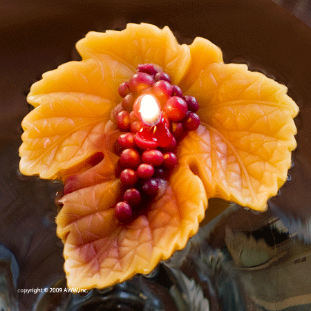 Original grape leaf wine country floating candle made by Armadilla Wax Works.