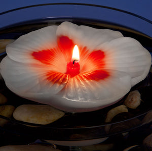 Floating Hibiscus 5 inch diameter candle for pool and centerpiece settings. Armadilla Wax Works.