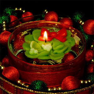 Mistletoe design floating holiday candles made with artisan details.