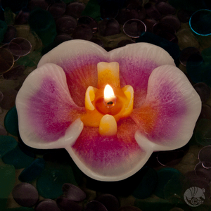 Orchid floating candles are handmade with unique swirls of wax, no paint.