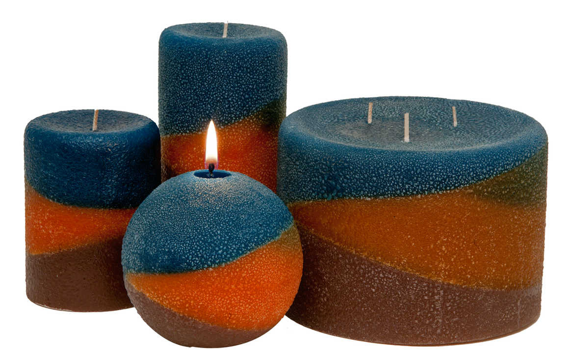 Copper canyon pillar candles. rich colors and fragrances are layered together: Patchouli ~ Orange ~ Sandalwood.