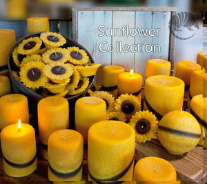 Gentle floral scented pillar candles with sunflower colors of yellow and brown.