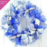 Ready to Ship Winter wreath with royal blue, white and silver mesh on a white front door