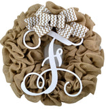 Burlap Wreath with white F monogram in middle and burlap and white chevron bow