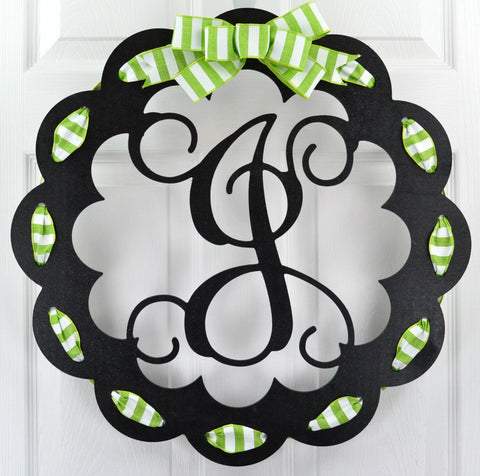 Black door hanger with letter J and lime and white striped ribbon and bow