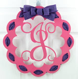 Pink door hanger with purple ribbon