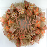 Jute fall colored wreath with sparkly Hello Fall sign in the center