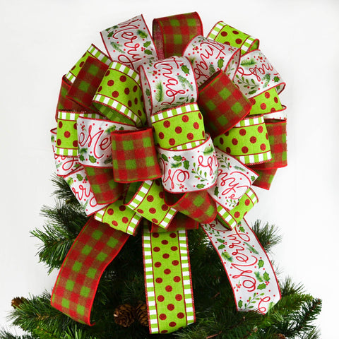 Christmas tree bow on top of a tree, with a lime and red polka dot ribbon, white printed ribbon and red lime plaid ribbon