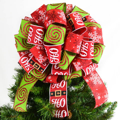 Christmas Tree Bow with red and lime ribbons, one with Santa print, on top of a Christmas tree