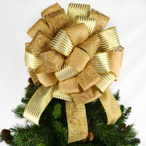 Gold Christmas Tree Bow with twelve inch streamers on top of a tree
