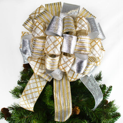 Gold and Silver Christmas Tree bow with 12 inch tails sitting atop a tree