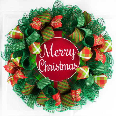 Red and Green Merry Christmas wreath on a white door