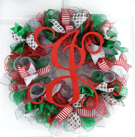 red and silver and emerald green Christmas wreath with red monogram J in the center