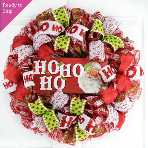 Ready to Ship Red White and Lime Green Mesh Wreath with a wooden Ho Ho Ho sign with a Santa Face on the sign, all hanging on a white door