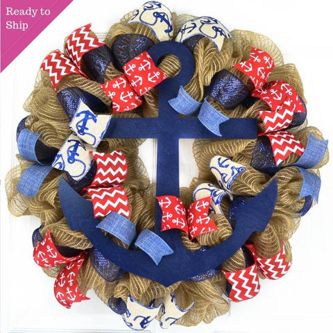 Jute mesh wreath with red, navy and white ribbons and a navy blue anchor in the center